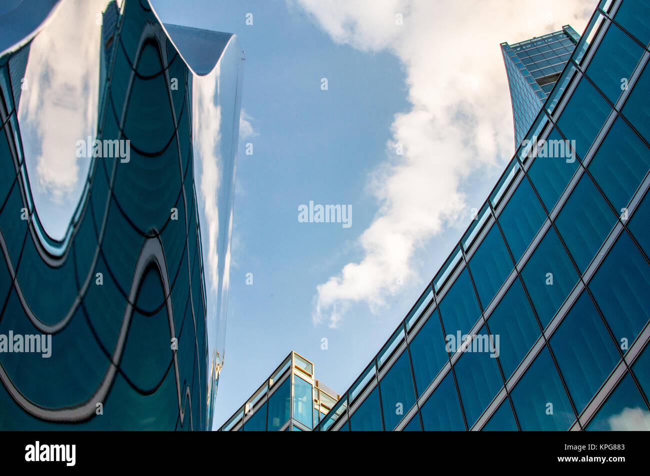 Modern skyscraper reflected on a deforming surface - Stock Image