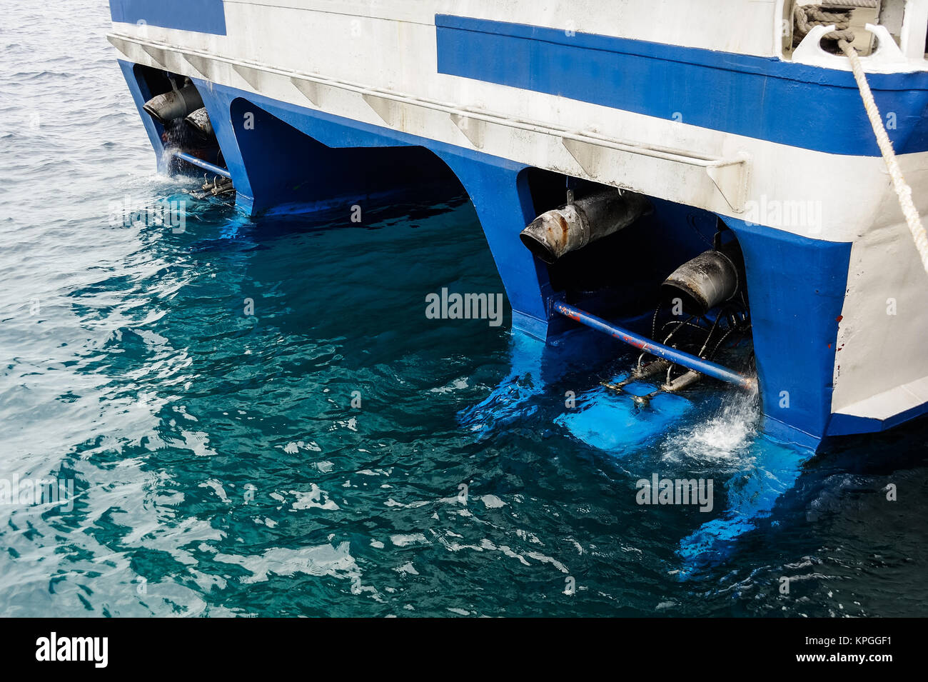stern of a ship with the exhaust pipe of the diesel engine Stock Photo