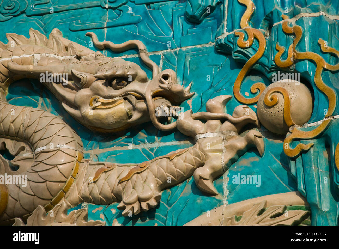 China, Beijing, Xicheng District. Behai Park- Detail of the Nine Dragon Screen. - Stock Image