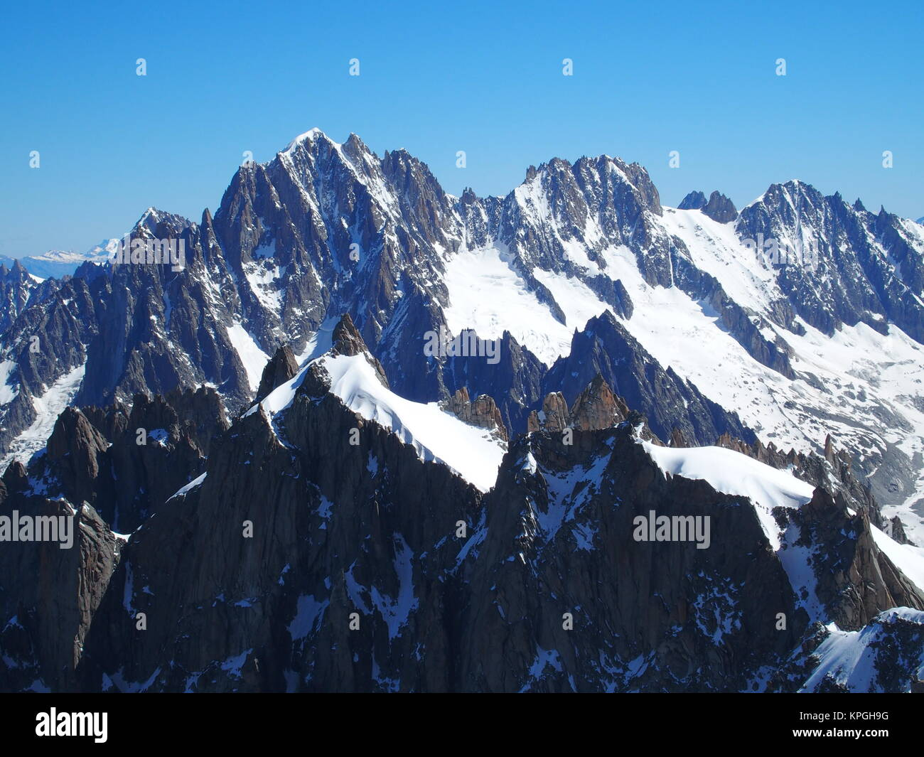 Alpine mountains range landscape in French ALPS seen from Aiguille du Midi at CHAMONIX MONT BLANC in FRANCE - Stock Image