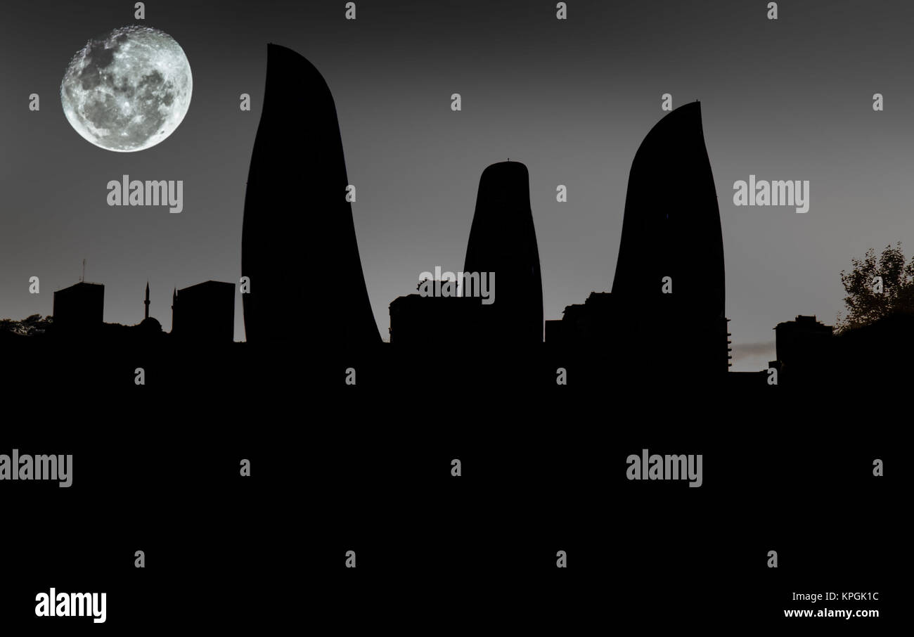 Silhouettes of Flame Towers skyscraper on sunset in Baku,  Azerbaijan. - Stock Image