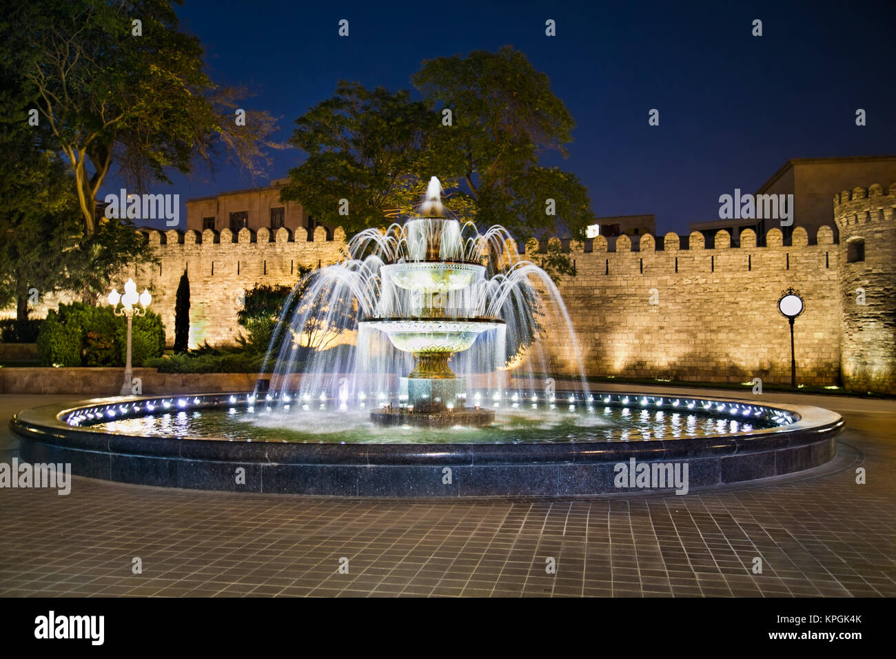 Fountain in front of ancient fortress wall in Baku old town, Azerbaijan. - Stock Image