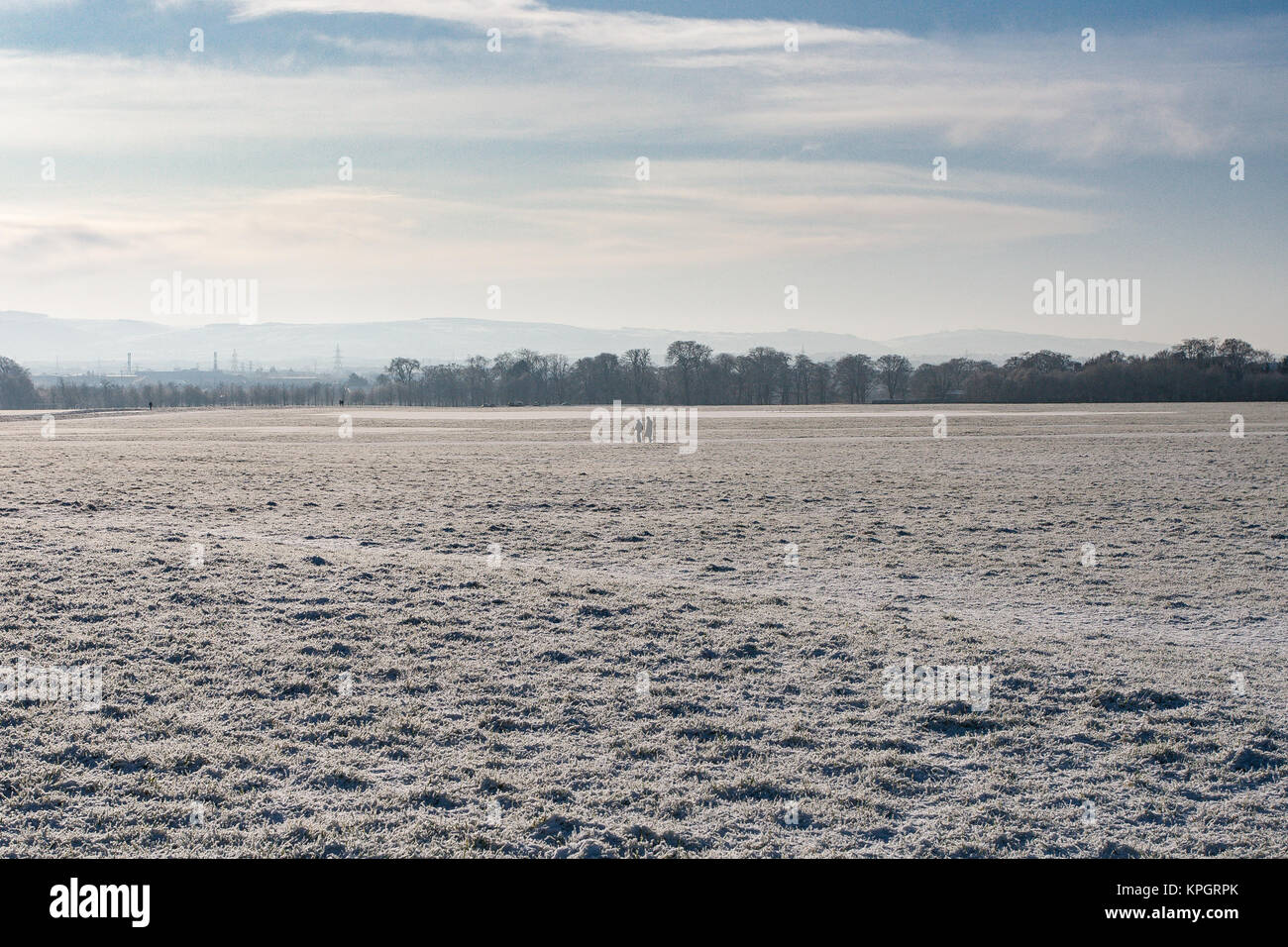 People waling in snow in the Phoenix Park in Dublin on a beautiful winter morning on the first day of the New Year Stock Photo
