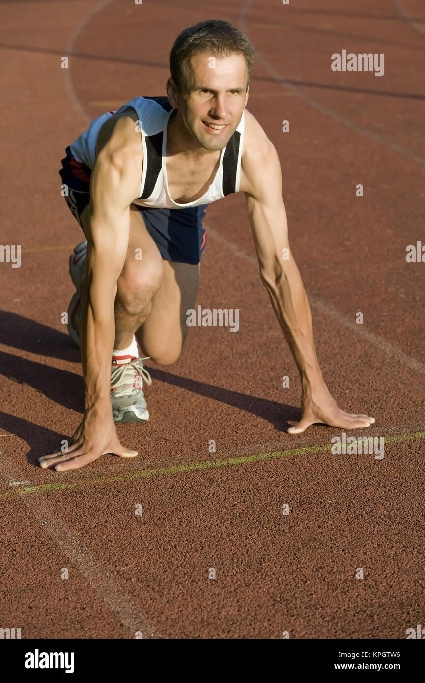 Model released , L?ufer am Start - runner at the start - Stock Image