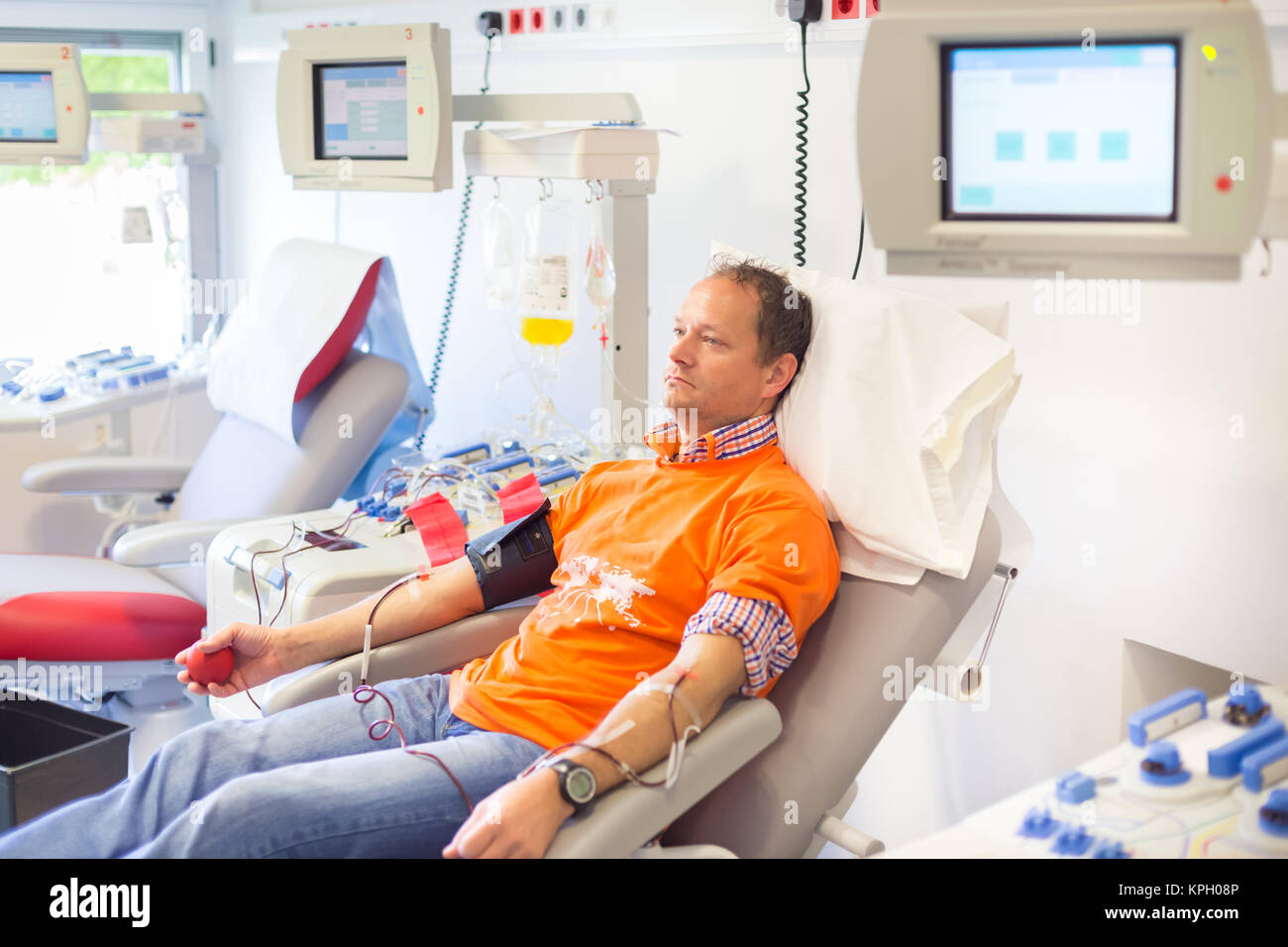 Blood donor at donation. - Stock Image