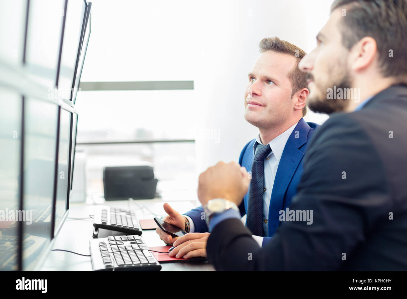 Successful businessmen in office. Business success. - Stock Image