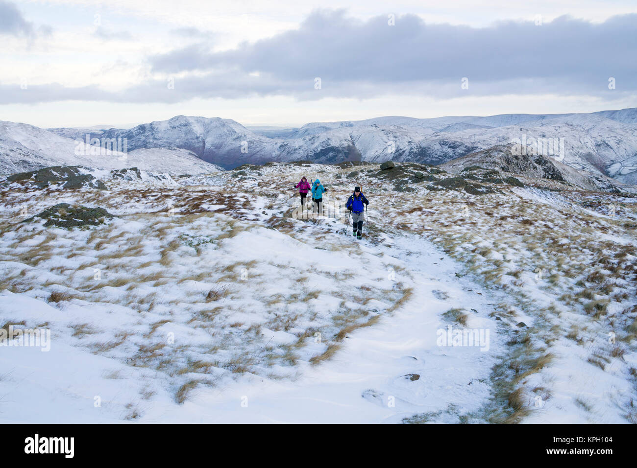 Walkers on Hartsop Above How in Winter, Lake District, Cumbria, UK - Stock Image