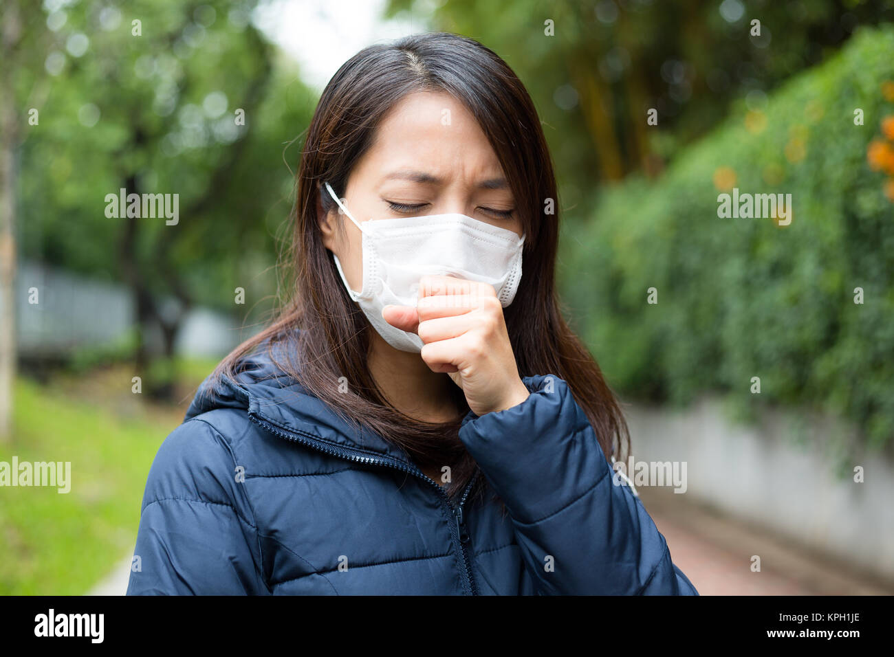 Young Woman wearing face mask - Stock Image