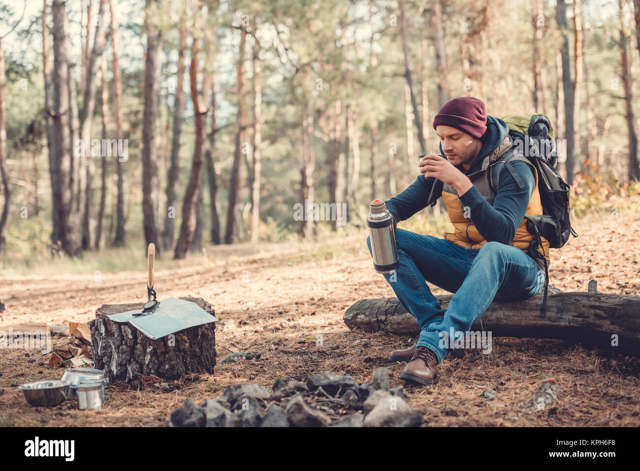 man drinking tea in forest - Stock Image