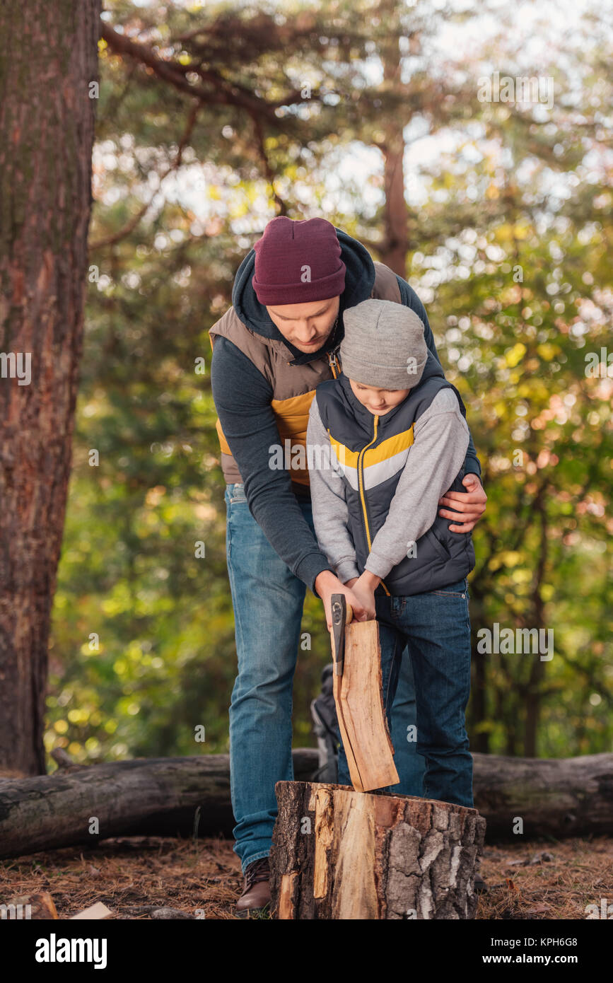 father and son chopping firewood - Stock Image