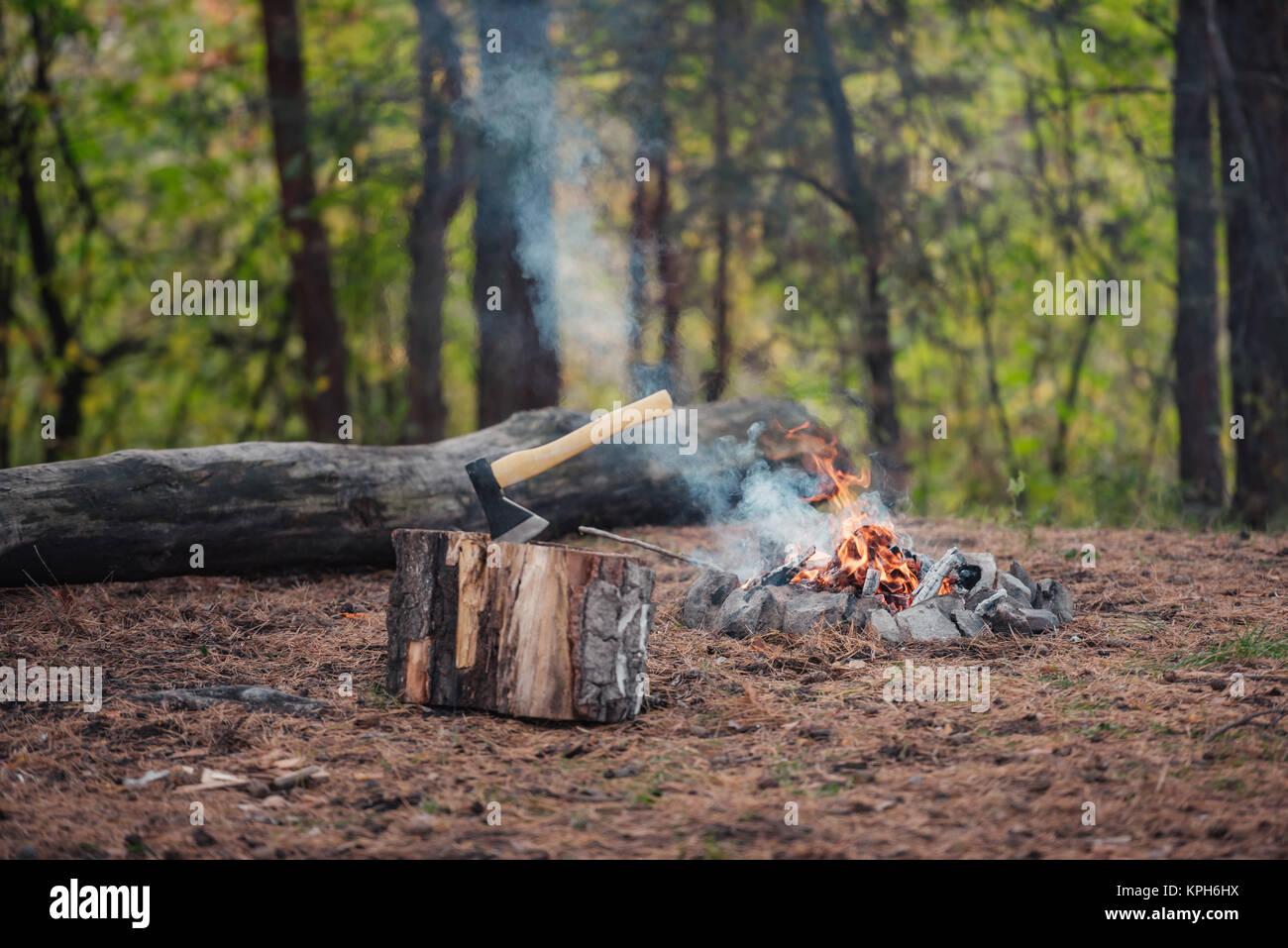 axe and bonfire  - Stock Image