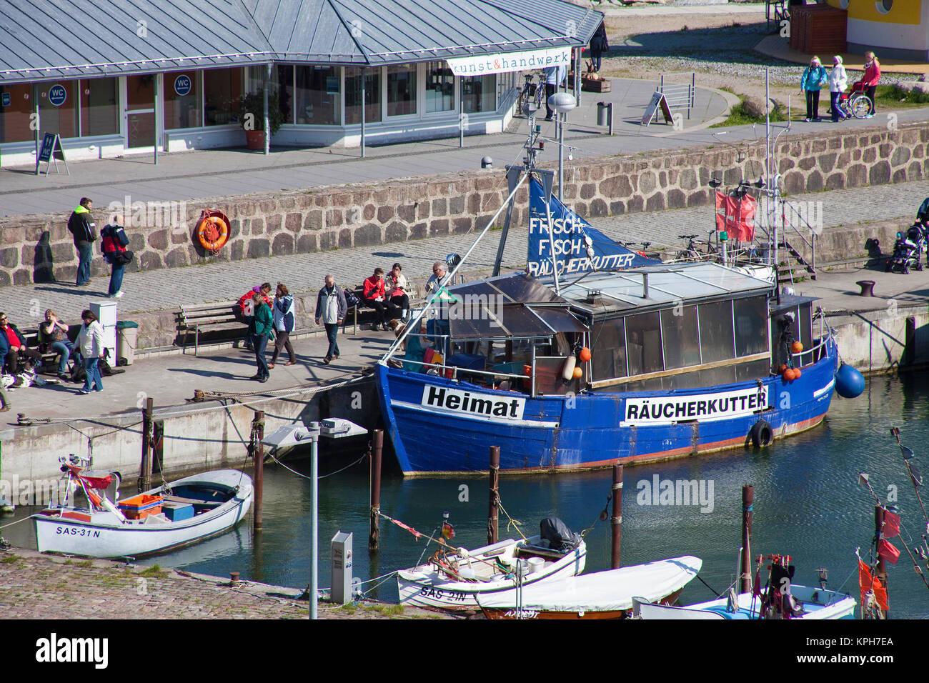 Smoking fish cutter at harbour of Sassnitz, Ruegen island, Mecklenburg-Western Pomerania, Baltic Sea, Germany, Europe Stock Photo