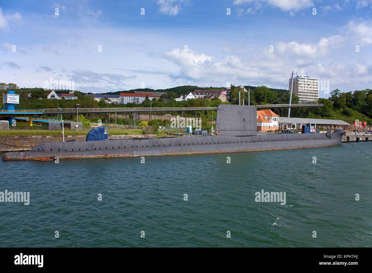 British submarin HMS Otus at harbour, used as museum, behind hotel Ruegen and pedestrian bridge, Sassnitz, Ruegen - Stock Image