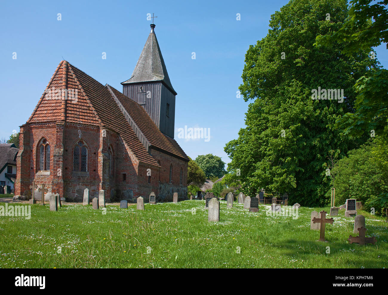 Village church with wooden tower, gotic style, cementary, Gross Zicker, Ruegen island, Mecklenburg-Western Pomerania, - Stock Image