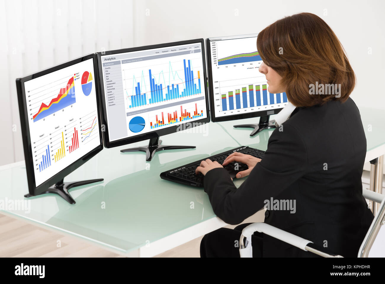 businesswoman working with graphs on computer stock image