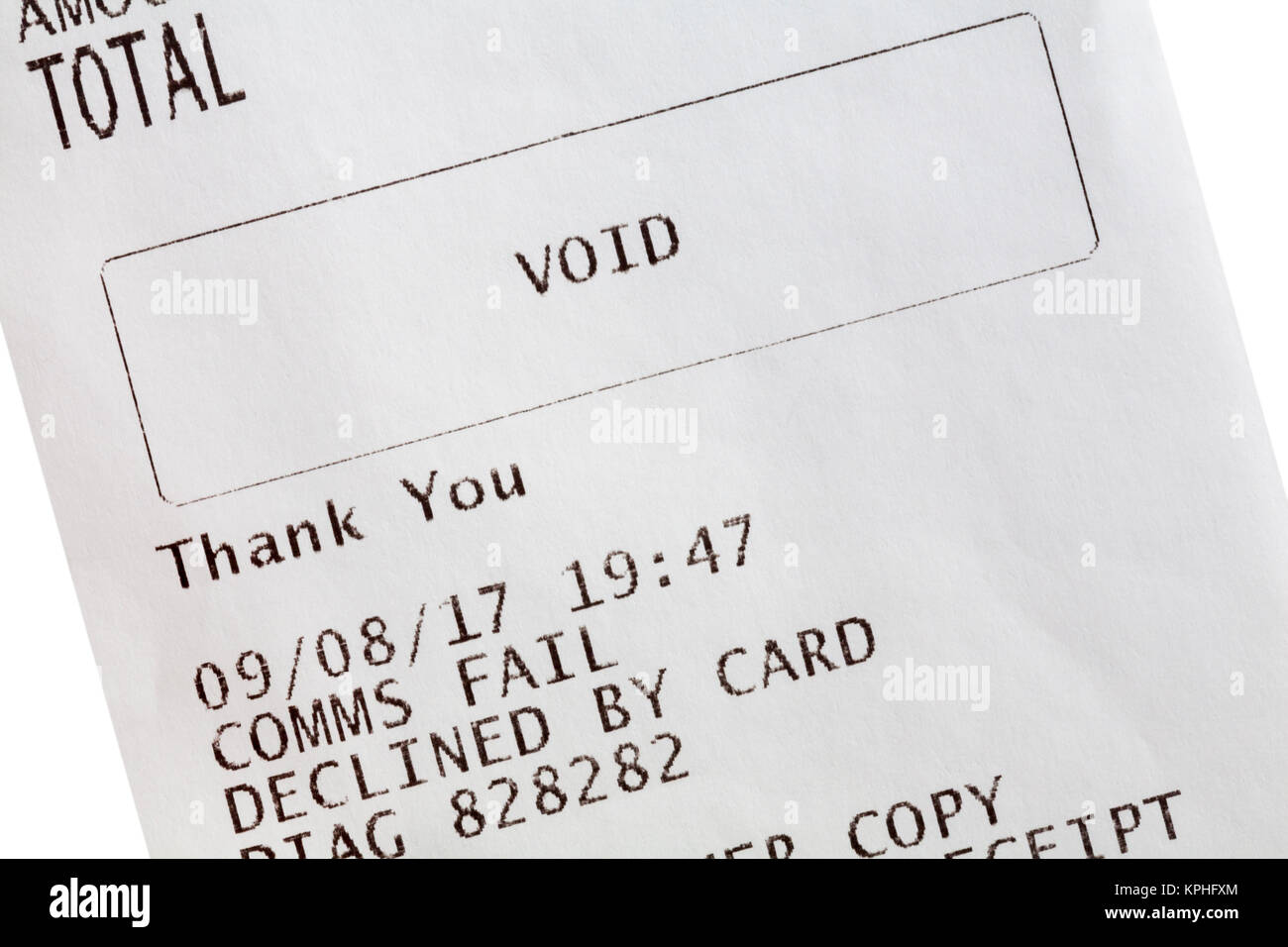Void comms fail detail on paper roll receipt from card payment transaction - Stock Image