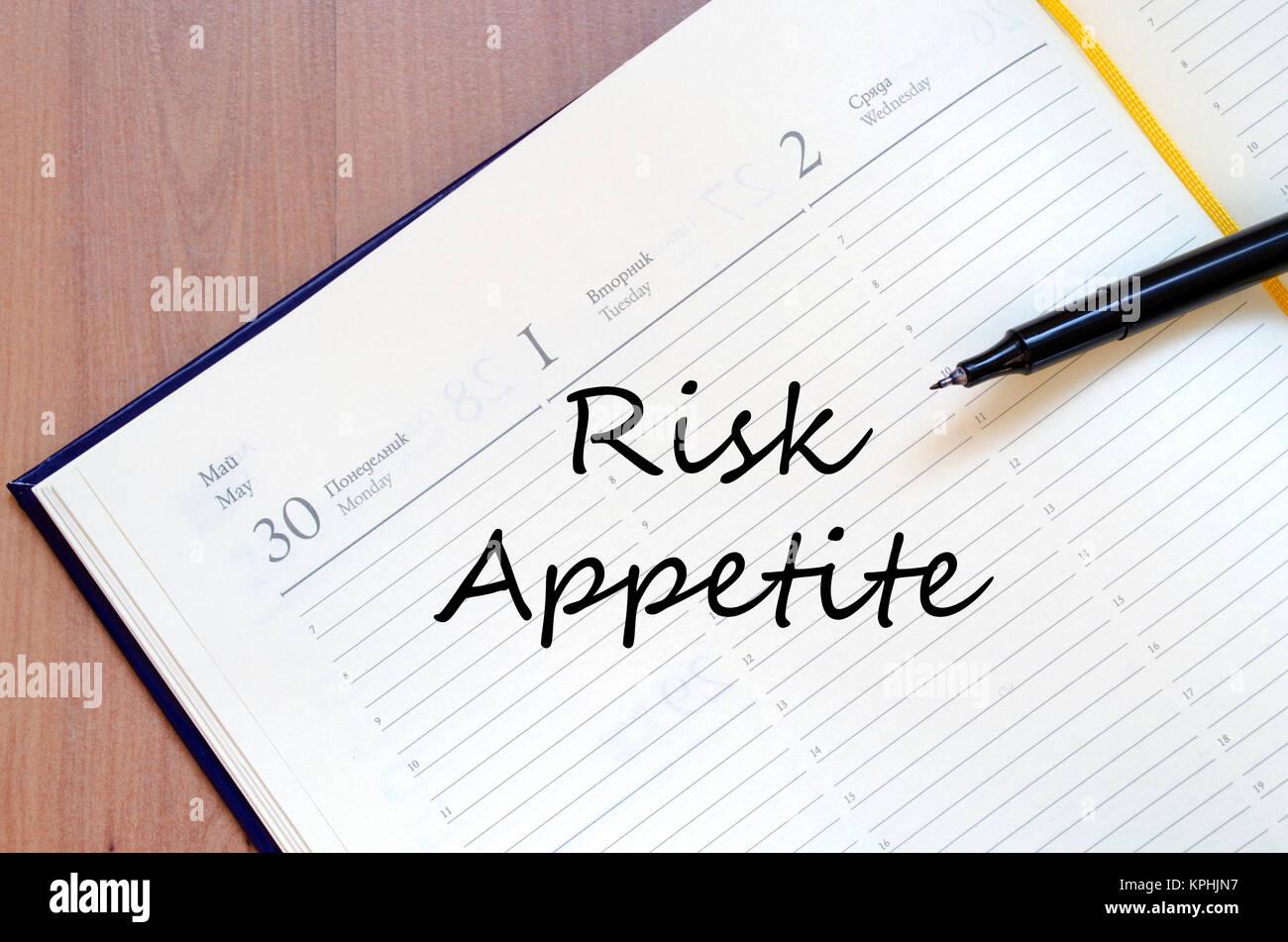 Risk appetite write on notebook Stock Photo