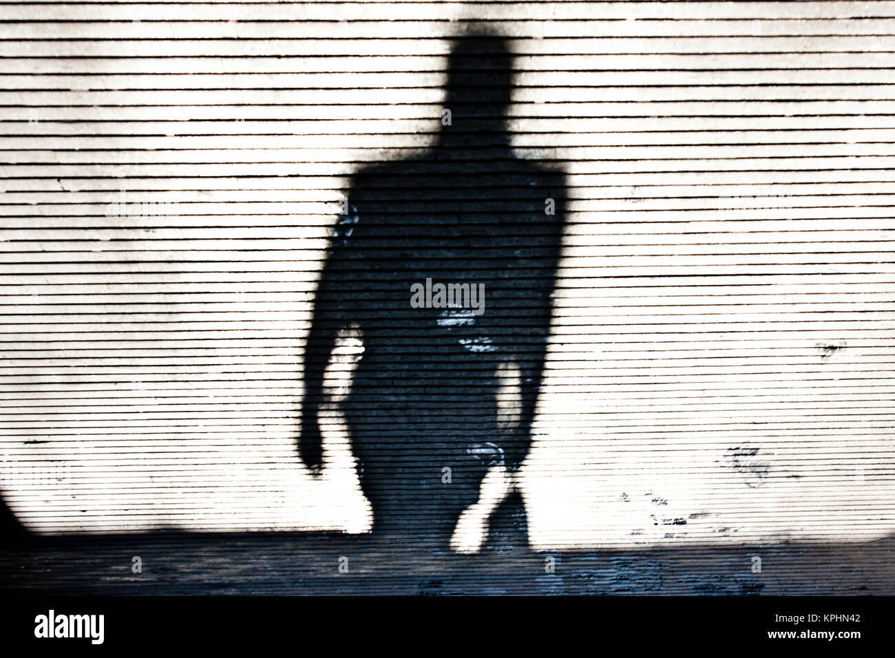 Blurry shadow of a person walking - Stock Image