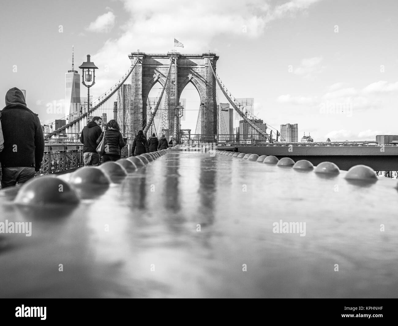 NEW YORK, USA - JANUARY 5, 2015: The Brooklyn Bridge receives thousands of pedrstrians and cyclists cross each day. - Stock Image