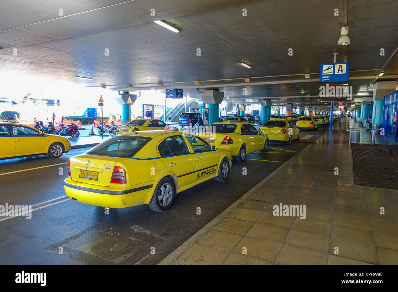 Yellow taxis queueing outside Athens Airport, Greece Stock Photo
