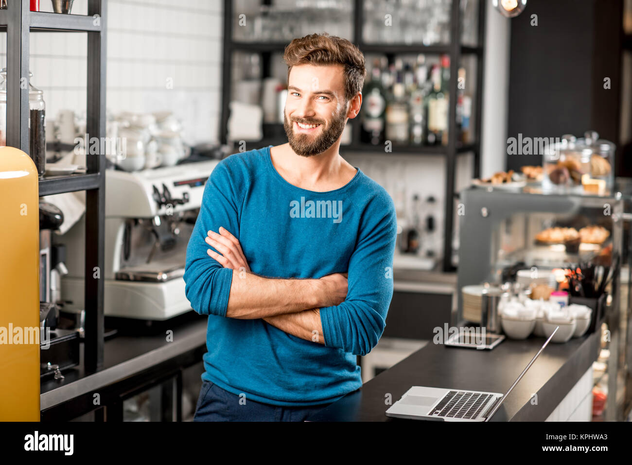 Portrait of a handsome cafe owner - Stock Image