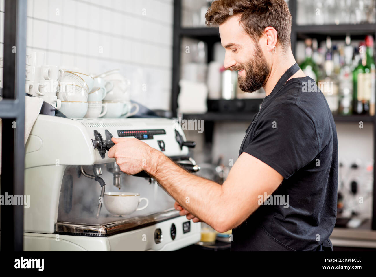 Barista making coffee - Stock Image