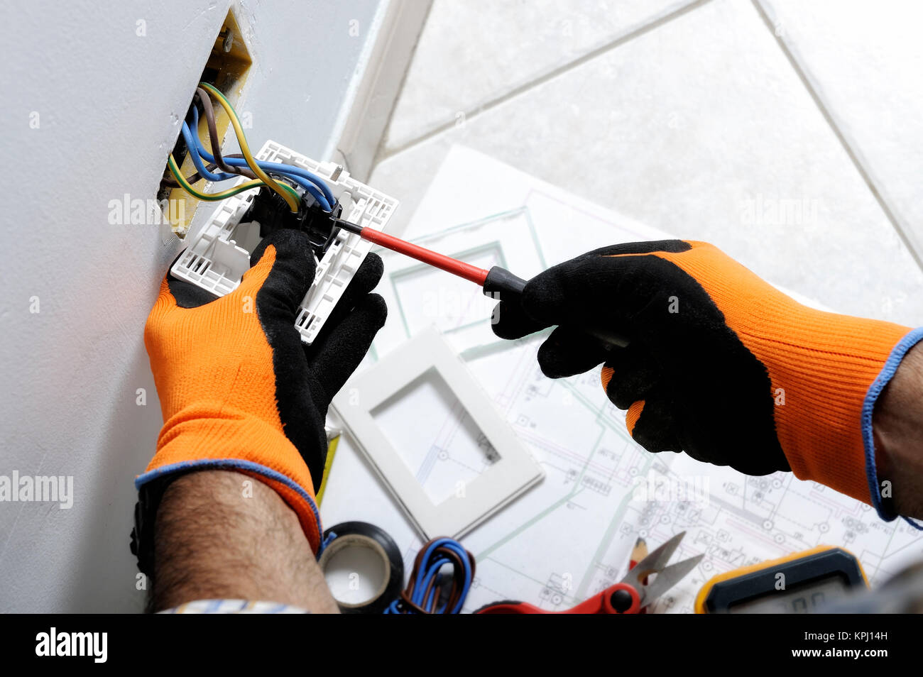 Electrician working safely on switches and sockets of a residential ...