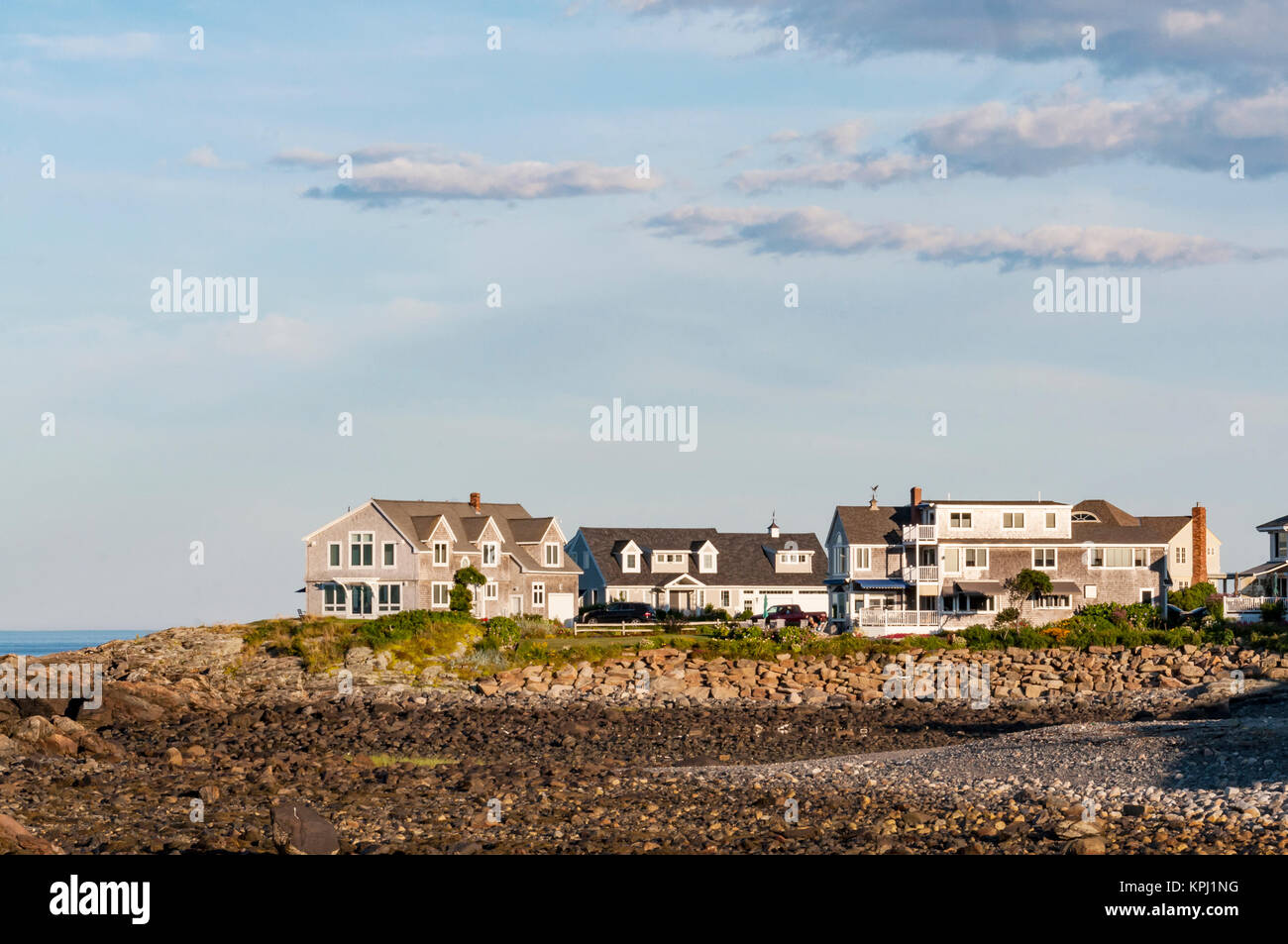 Houses near the coastline with blue and clean sky in Maine, USA - Stock Image