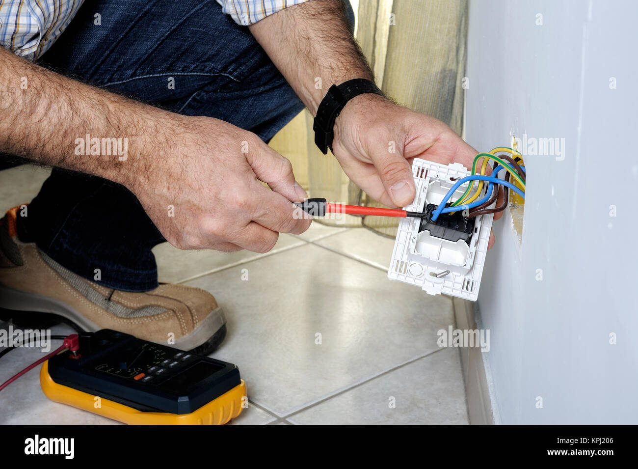 Electrician At Work On Switches And Sockets Of A Residential Electrical System