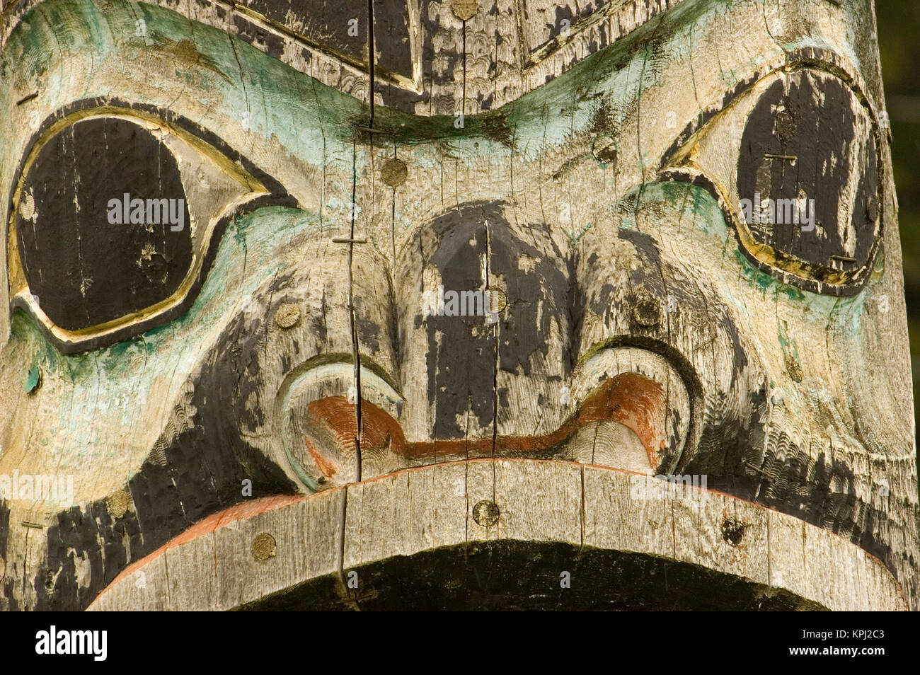 North America, USA, AK, Inside Passage. Totem Pole (world's tallest) face,  in Tlingit town of Kake on Kupreanof - Stock Image