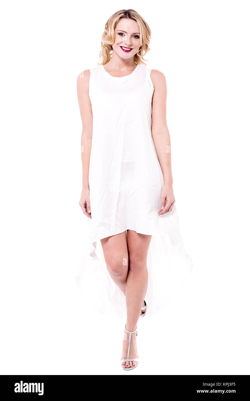 Attractive woman wearing white dress - Stock Image