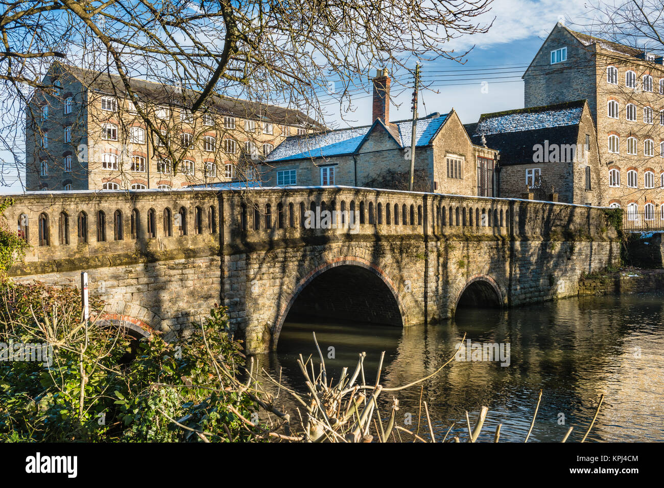 A short walk from the town centre, St Johns Bridge crosses the River Avon to the historic Silk Mills on the edge - Stock Image