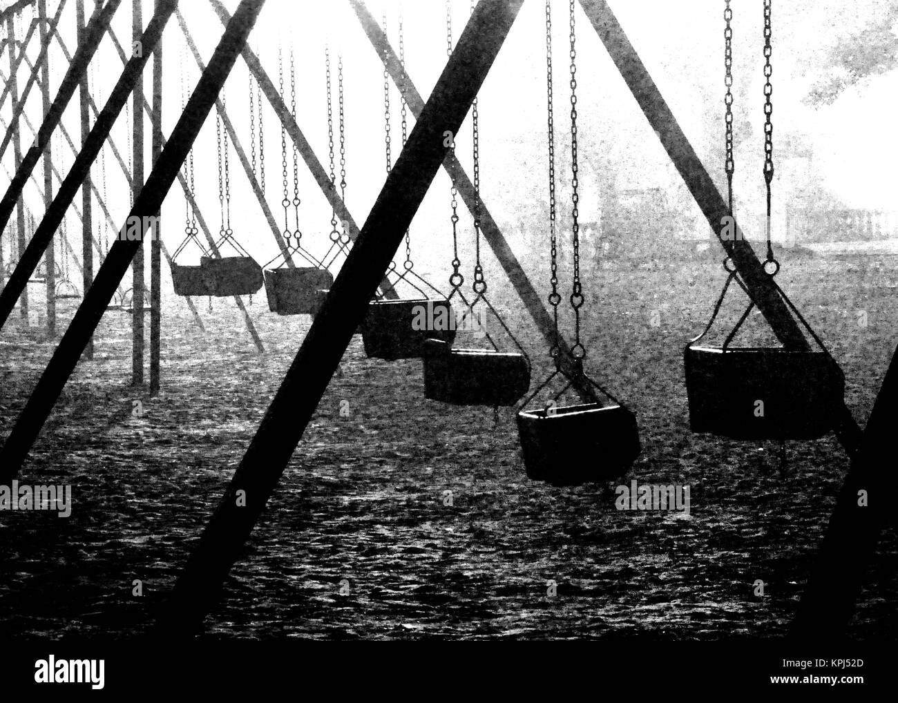 Silhouette seasaws in a Argentine park taken in a foggy day. Buenos Aires, Argentina - Stock Image
