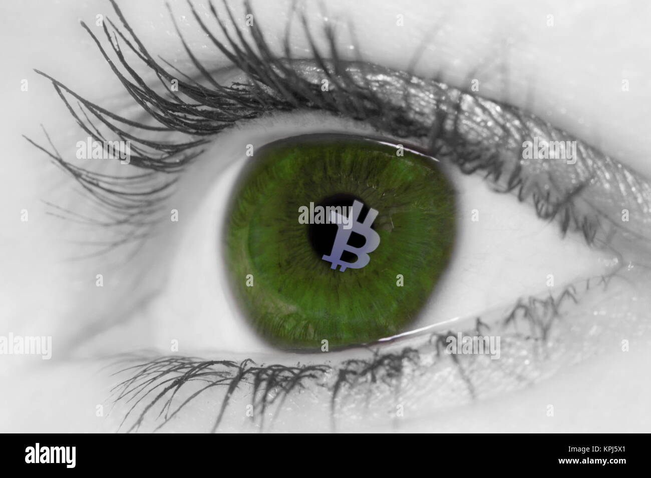 A Bitcoin reflection of screen in  womans eye - Stock Image