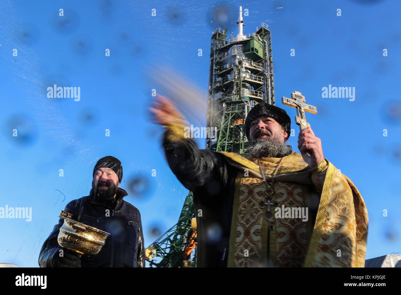 Baikonur, Kazakhstan. 16th Dec, 2017. A Russian Orthodox priest blesses the Soyuz FG rocket and the Soyuz MS 07 Stock Photo