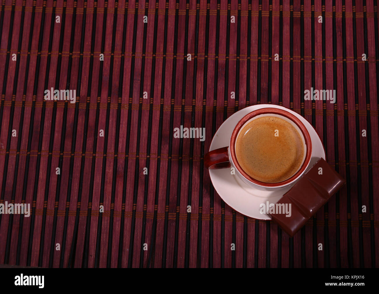 Coffee cup and chocolate on wooden table texture. Coffeebreak - Stock Image