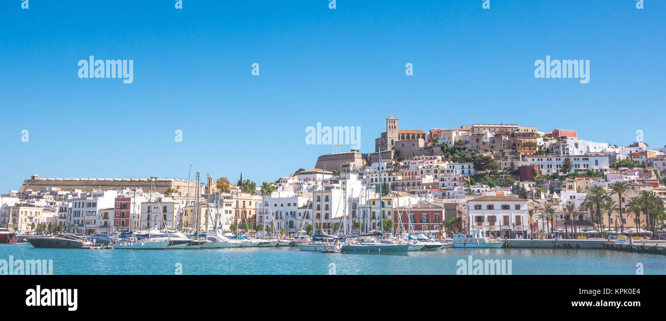 Beautiful light of the sun over the city of Ibiza in pamorma format - Stock Image