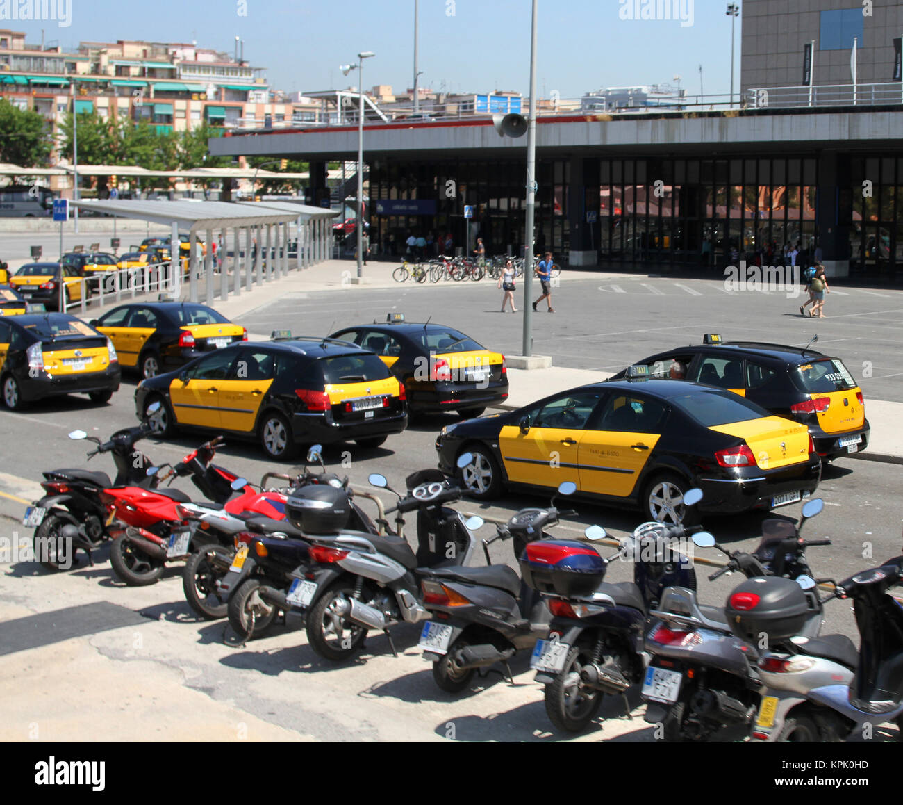 Skoda auto taxi cab in parking lot of Sants Railway Station with Scooters, Barcelona, Spain. - Stock Image