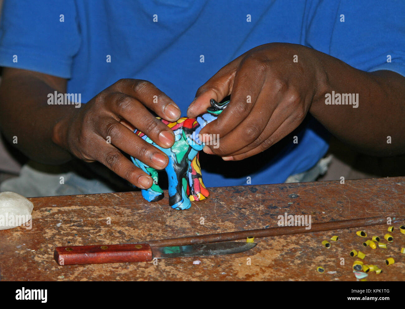 Candlemaker with carved colourful elephant shaped candle, Kingdom of Swaziland. Stock Photo