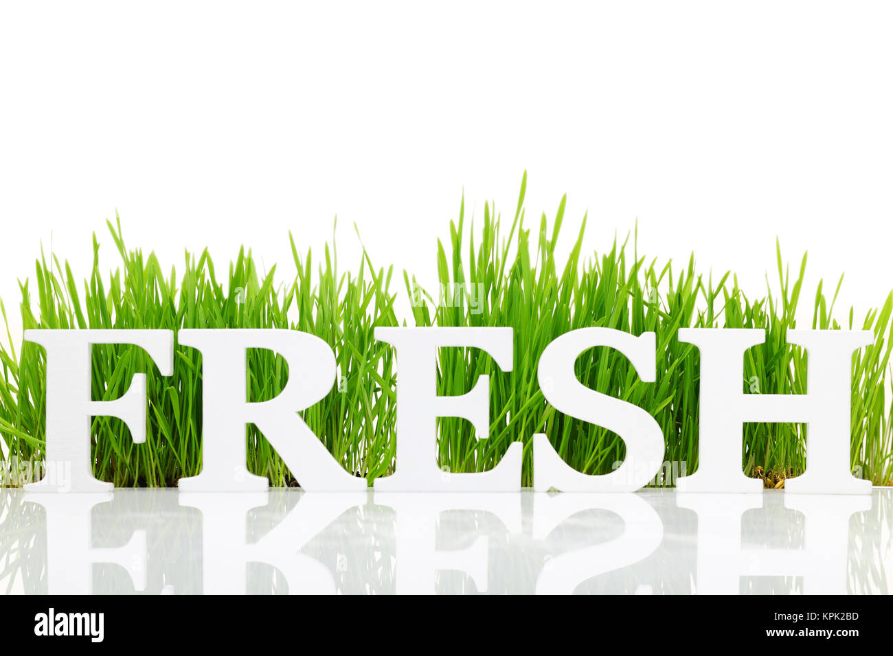 Word 'Fresh' with fresh grass isolated on white - Stock Image