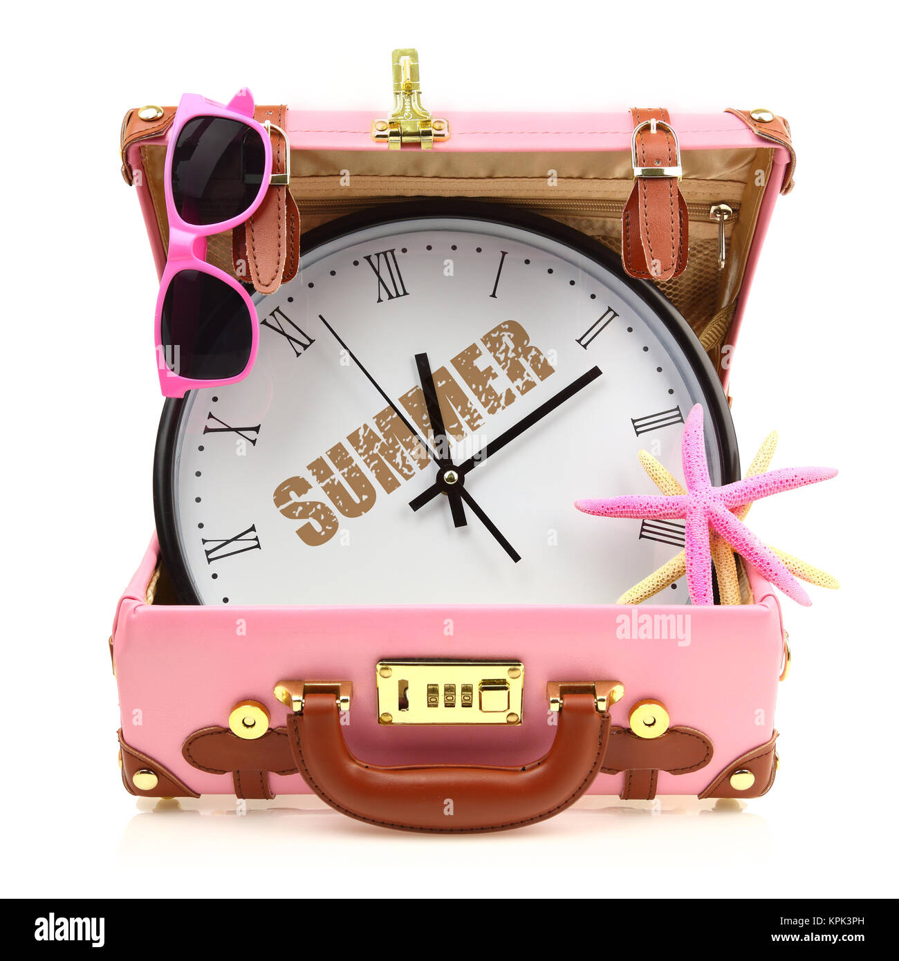 Pink travel suitcase with clock, sunglasses and starfish isolated - Stock Image