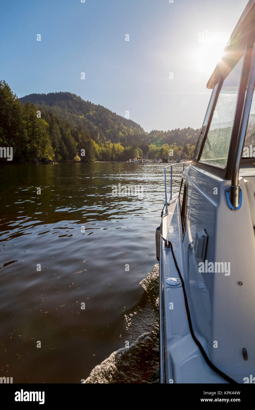 The view of the entrance to Snug Cove on Bowen Island as this boat approaches the marina late in the day when the - Stock Image