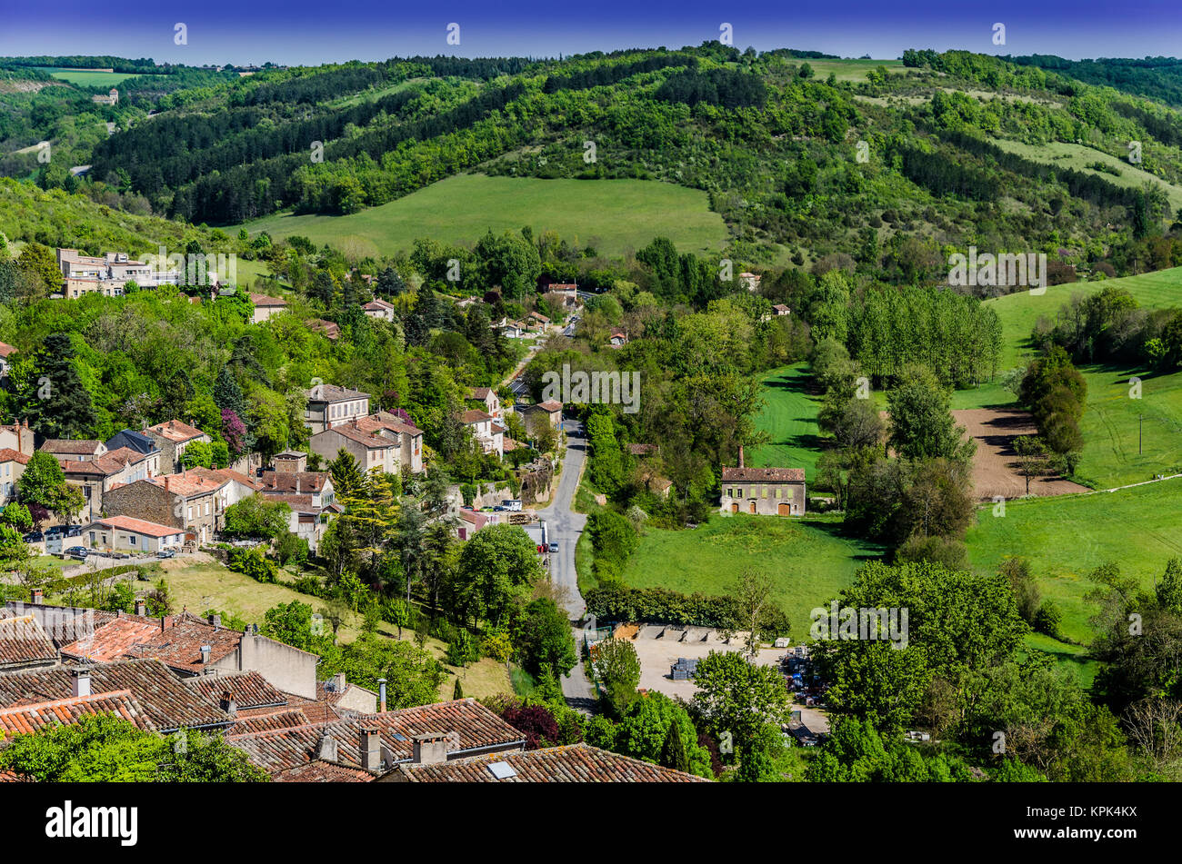 On the outskirts of the French village of St. Cirq Lapopie is this beautiful valley with all possible greens, last - Stock Image