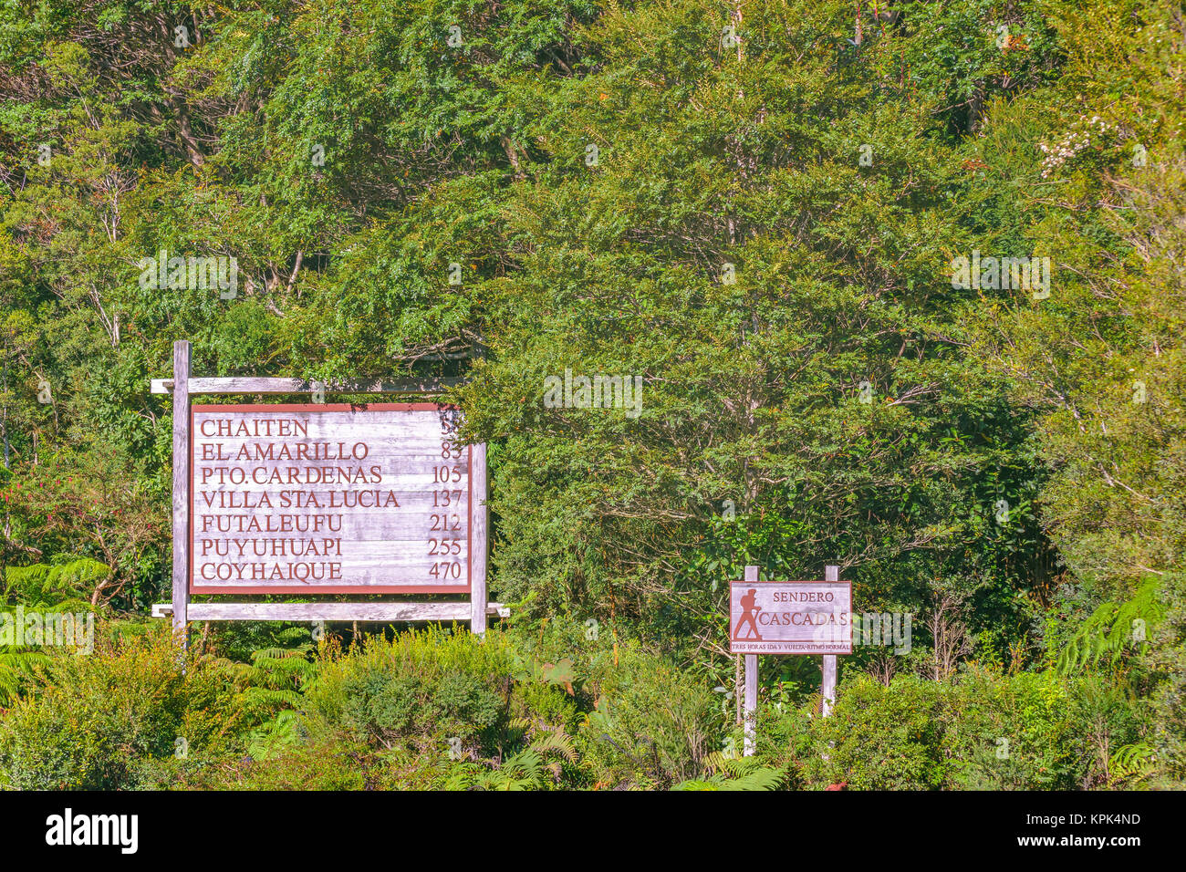 LOS LAGOS, CHILE, APRIL - 2017 - Travel information signpost at leafy forest in Caleta gonzalo, Chile - Stock Image
