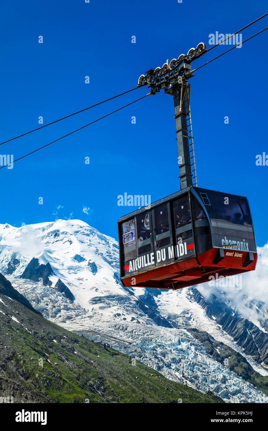 Mont Blanc and Aiguille du Midi Cable Car under blue sky, viewed from Plan de l'Aiguille; Chamonix-Mont-Blanc, - Stock Image