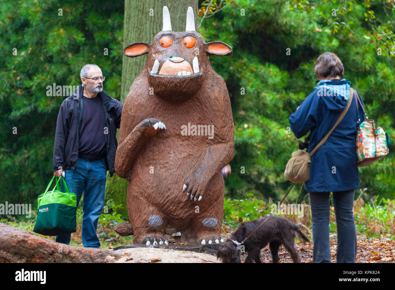 A man poses for a photo with the gruffalo at the Bedgebury National Pinetum at Bedgebury, Kent - Stock Image