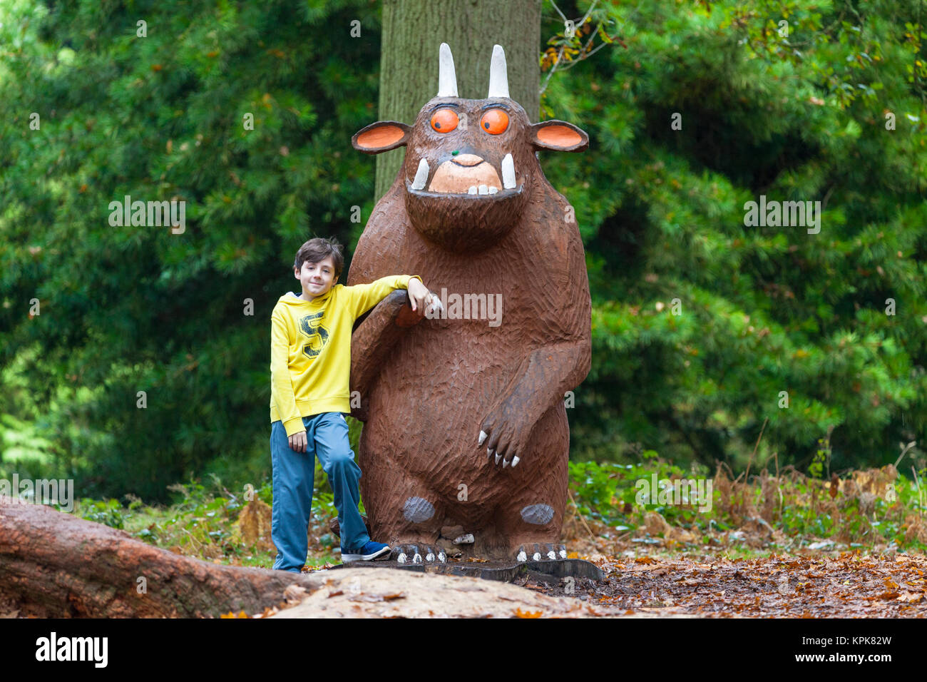 A boy posing with the gruffalo at the Bedgebury National Pinetum at Bedgebury, Kent - Stock Image