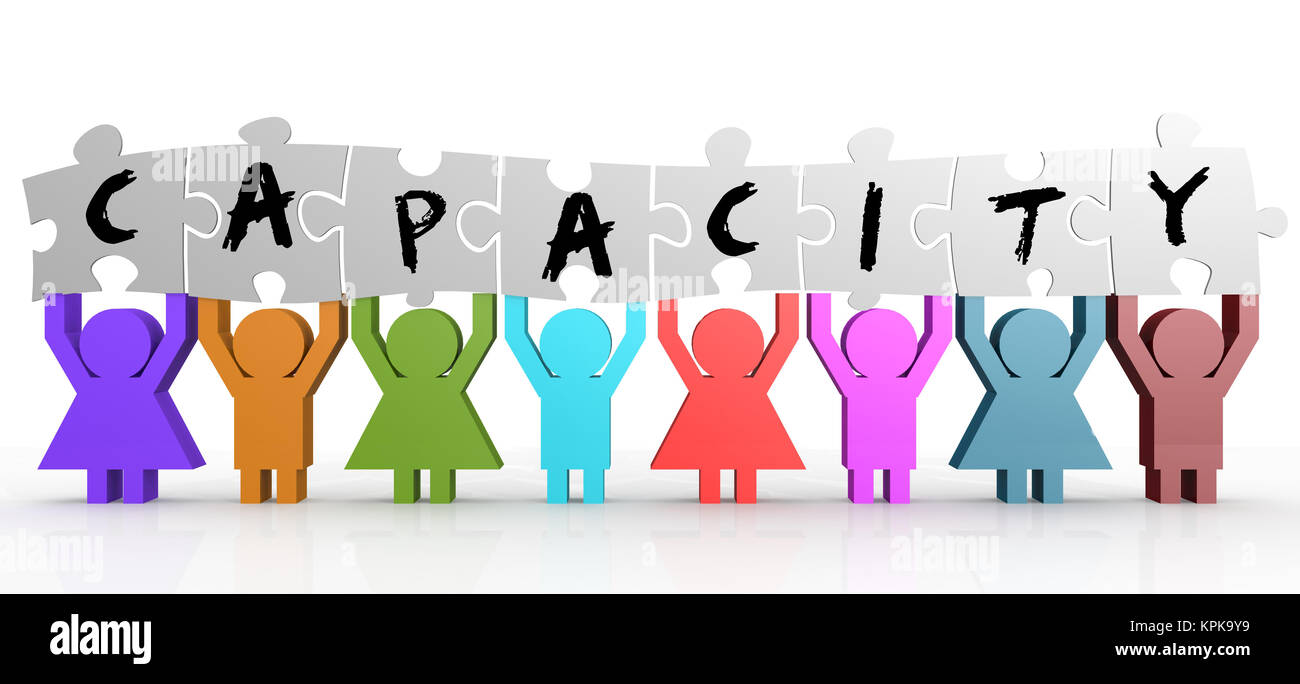 Puppet hold puzzle with capacity word on it - Stock Image