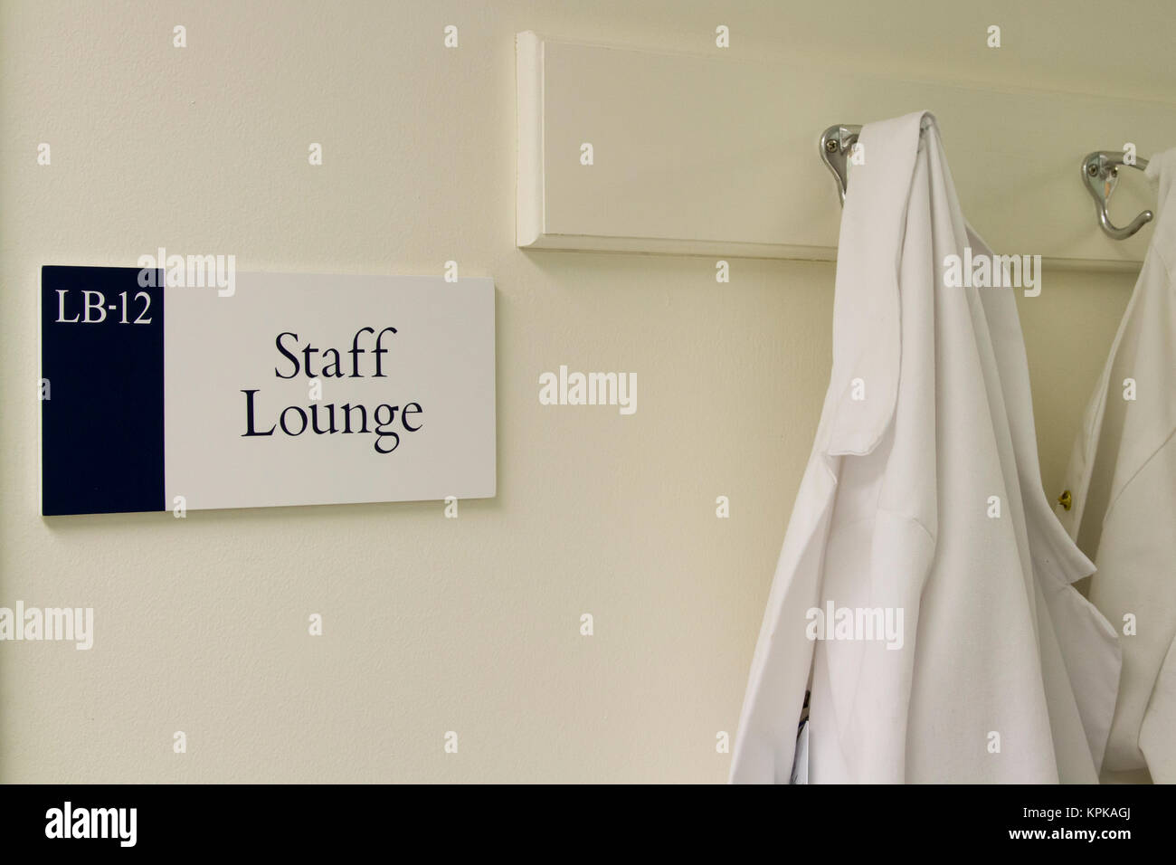 Lab coat at staff lounge in hospital laboratory. - Stock Image
