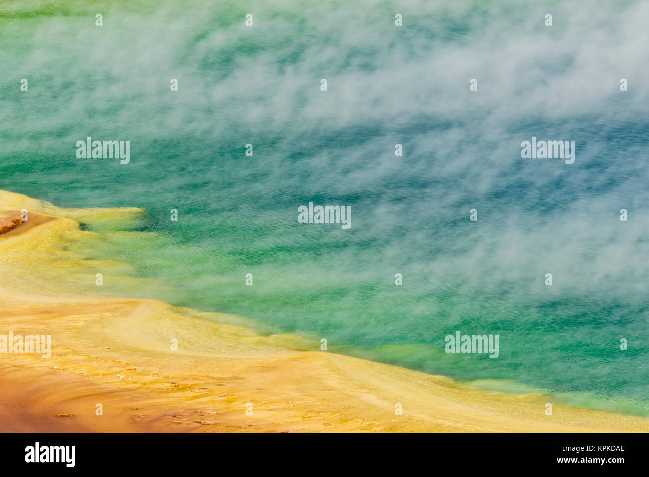 Elevated view of Grand Prismatic Spring and patterns in bacterial mat, Midway Geyser Basin, Yellowstone National Park, Wyoming. Stock Photo